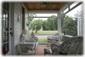 e Screened-In Porch w/ ceiling fan overlooking gardens