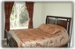"""2nd bedroom with 32"""" LCD on wall"""