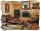 """Family Room Features Fireplace and Built-Ins to Accomodata a 57"""" Wide Screen TV"""