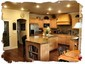 Modern Kitchen Features Granite Tile and Maple Cabinets