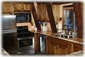 Kitchen has stainless appliances, slate floors and granite countertops