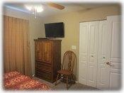The guest bedroom HD TV, DVD player & walk in closet