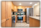 Our kitchen is outfitted for a chef with brand new stainless appliances, cookwar