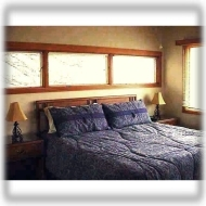 Bdrm 1 of 4 ~ This bdrm features a king-size bed and lovely mountain view