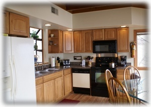 New Hickory cabinets, wood flooring, counter tops, range oven & more!