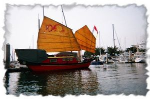 Get photos of yourself on this Authentic Chinese Junk or schedule a meal aboard