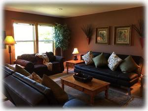 Comfortable downstairs with futons and pool table; great for the kids!