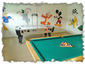 Air hockey and slate bed pool and toys add to the fun