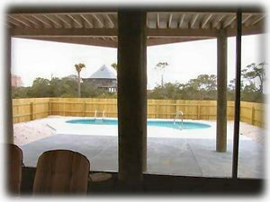 Here's a shot of the pool deck (without its furniture) from inside the porch