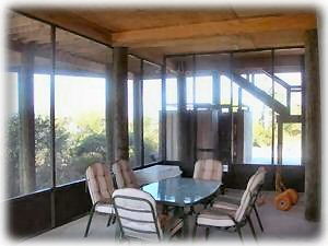 The large well furnished screened porch