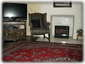 HDTV, Cozy Electric Fireplace, Oriental Carpet