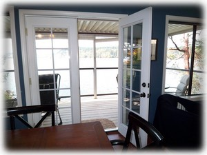 French doors lead to covered deck