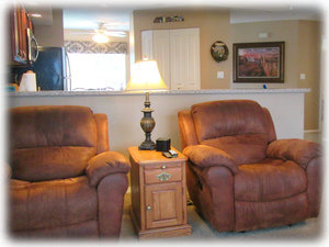 Two rocking recliners. Comforts of home