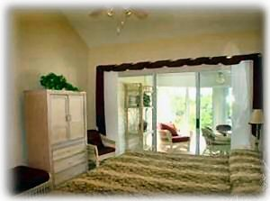Master Bedroom and sliding patio door to sunroom