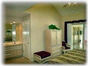 View of Master Bedroom with King Bed, dual sinks, skylight whirlpool shower/tub