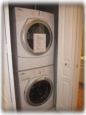 A washer and dryer are in the condo