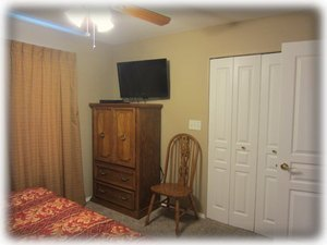 The guest bedroom HD TV, DVD player & walk in closet