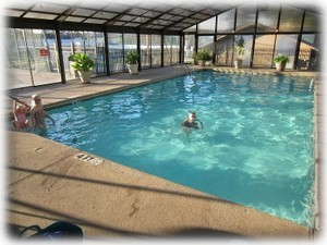 Indoor pool is part of club house complex. One block away.
