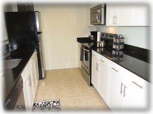 Remodeled kitchen with granite counter tops.  Very well-equipped for cooking
