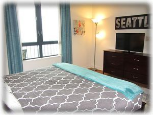 Spacious bedroom with king bed and 40 inch TV
