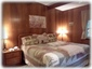Spacious Master Bedroom with King-Size Bed, Desk, & Ceiling Fan!