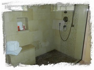 Master Bath walk-in shower with rain head and handheld showers - beautiful stone