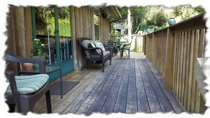 New Expanded Deck Leading to Backyard and Boardwalk