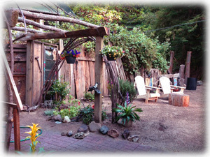 Relax in a lovely garden with fences by local artist