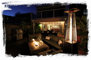 Our magical back deck includes a fire table, pyramid patio heater, and gas grill