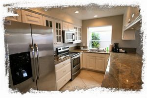Kitchen has all stainless steel appliances and plenty of cabinet & counter space
