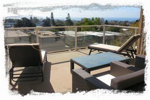Soak in the San Diego sun on the balcony with chaise lounges & club chairs