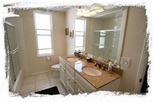 Master bathroom features dual vanities