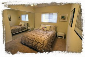 2nd bedroom furnished with a brand new Sealy Posturepedic queen bed