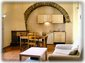 Open Living/Dining Area with vaulted ceiling, fireplace and origional stone-work