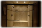 2 Person Spa Shower decorated in Travertine Tile and Oil Rubbed Bronze Fixtures